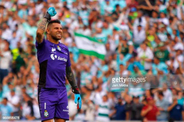 Jonathan Orozco of Santos celebrates the first goal of his team scored by his teammate Osvaldo Martinez during the quarter finals second leg match...