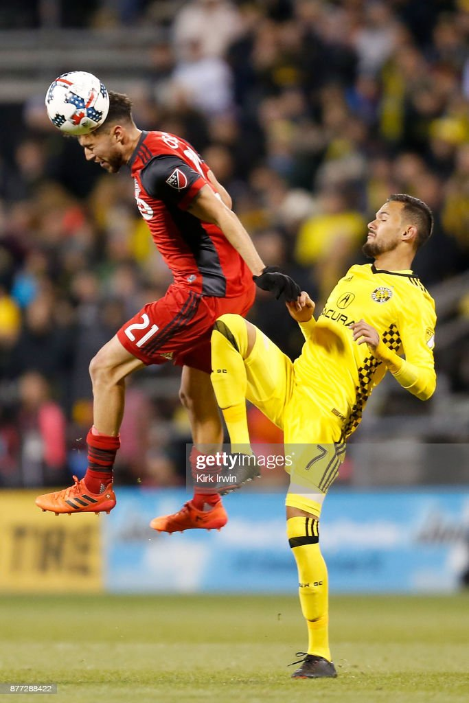 Jonathan Osorio #21 of the Toronto FC heads the ball away from Artur #7 of the Columbus Crew SC during the second half at MAPFRE Stadium on November 21, 2017 in Columbus, Ohio. Columbus tied Toronto 0-0.