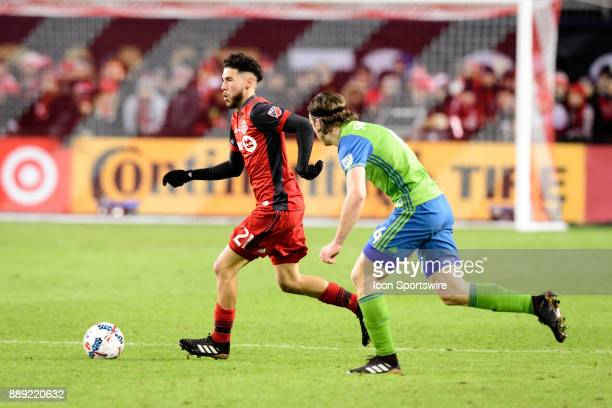 Jonathan Osorio of Toronto FC is chased by Gustav Svensson of Seattle Sounders FC during the 2017 MLS Cup Final between Toronto FC and Seattle...