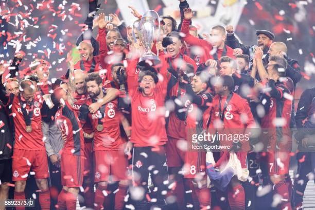 Jonathan Osorio of Toronto FC lifts the MLS Cup trophy and celebrates with his team mates after the 2017 MLS Cup Final between Toronto FC and Seattle...