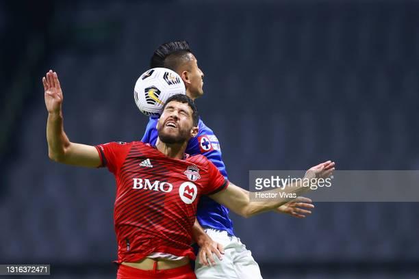 Jonathan Osorio of Toronto FC struggles for the ball against Roberto Alvarado of Cruz Azul during the quarterfinals second leg match between Cruz...
