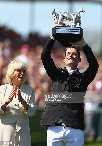 Jonathan Paget of New Zealand lifts the winners trophy as CamillaDuchess of Cornwall looks on during the showjumping test at Badminton horse trials...