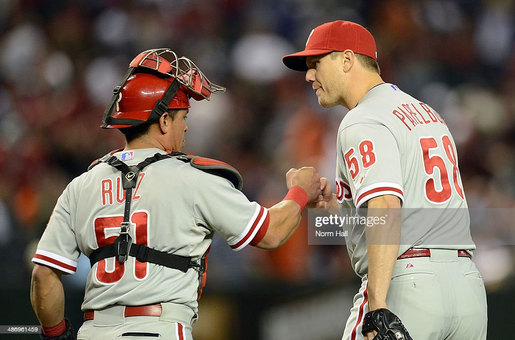 Jonathan Papelbon #58 and Carlos Ruiz #51 of the Philadelphia Phillies celebrate a 6-5 win against the Arizona Diamondbacks at Chase Field on April 26, 2014 in Phoenix, Arizona.