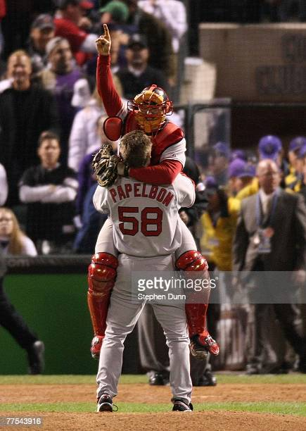 Jonathan Papelbon and Jason Varitek of the Boston Red Sox celebrate after winning Game Four by a score of the 43 to win the 2007 Major League...
