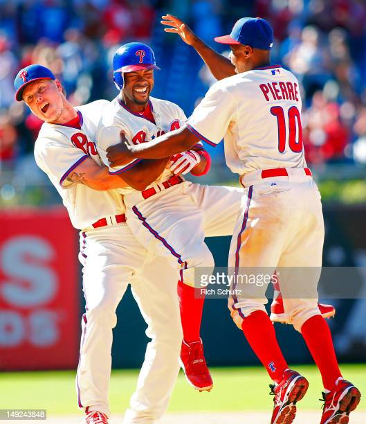 Jonathan Papelbon Juan Pierre of the Philadelphia Phillies mob teammate Jimmy Rollins after Rollins singled in Mike Fontenot with the game winning...