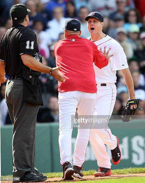 Jonathan Papelbon of the Boston Red Sox and home plate umpire Tony Randazzo are separated by manager Terry Francona of the Red Sox in the bottom of...