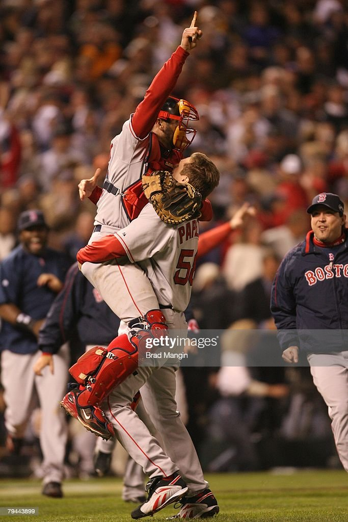 Jonathan Papelbon of the Boston Red Sox celebrates with Jason Varitek after winning Game Four of the World Series against the Colorado Rockies at Coors Field in Denver, Colorado on October 28, 2007. The Red Sox defeated the Rockies 4-3.
