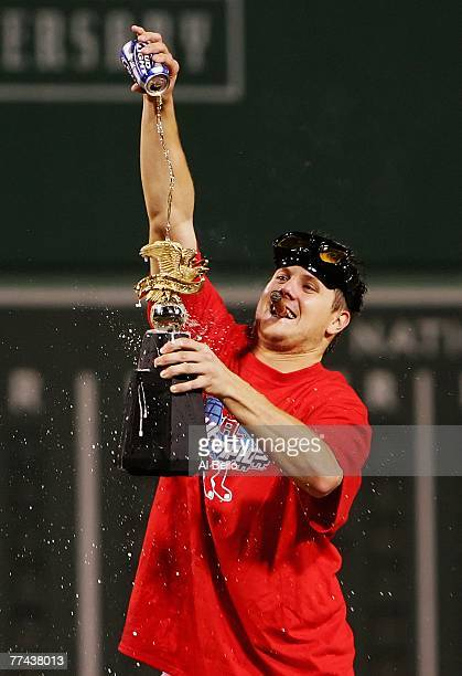 Jonathan Papelbon of the Boston Red Sox pours a beer over the William Harridge Trophy after defeating the Cleveland Indians by the score of 112 to...