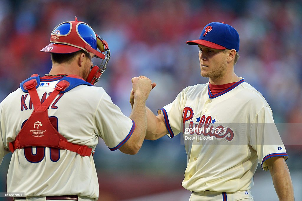 Jonathan Papelbon #58 of the Philadelphia Phillies is congratulated by teammate Erik Kratz #31 after defeating the Miami Marlins 3-1 at Citizens Bank Park on September 12, 2012 in Philadelphia, Pennsylvania.