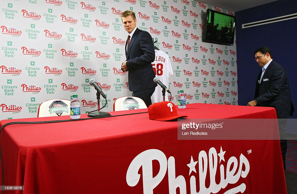Jonathan Papelbon walks onto the stage with General Manager Rubin Amaro Jr. of the Philadelphia Phillies as the Phillies signed the closer to a four-year, $50,000,058 contract, at Citizens Bank Park on November 14, 2011 in Philadelphia, Pennsylvania.