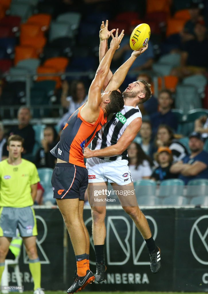 Jonathan Patton of the Giants and Lynden Dunn of the Magpies contest possession during the JLT Community Series AFL match between the Greater Western Sydney Giants and the Collingwood Magpies at UNSW Canberra Oval on March 1, 2018 in Canberra, Australia.