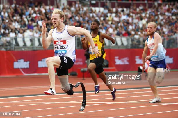 Jonathan Peacock of Great Britain crosses the line to win the Men's T44-64 100m during Day One of the Muller Anniversary Games IAAF Diamond League...