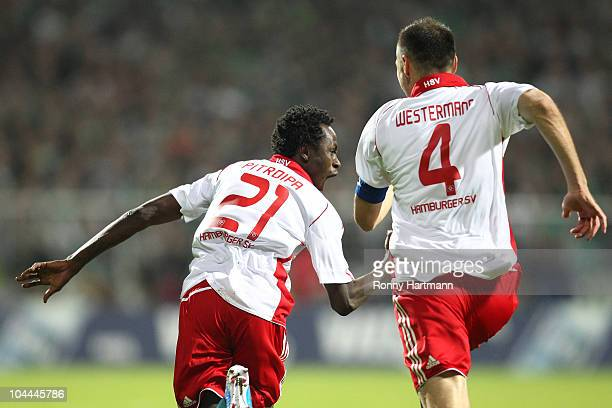 Jonathan Pitroipa of Hamburg celebrates with team mate Heiko Westermann after scoring his teams second goal during the Bundesliga match between SV...