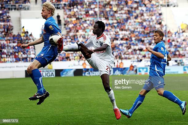 Jonathan Pitroipa of Hamburg is challenged by Andreas Beck and Boris Vukcevic of Hoffenheim during the Bundesliga match between 1899 Hoffenheim and...