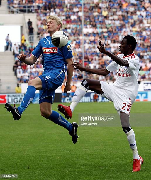 Jonathan Pitroipa of Hamburg is challenged by Andreas Beck of Hoffenheim during the Bundesliga match between 1899 Hoffenheim and Hamburger SV at the...