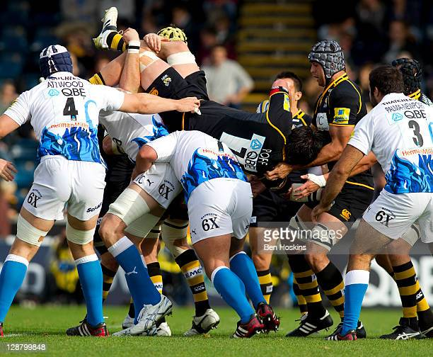 Jonathan Poff of Wasps is tackled in the air during the AVIVA Premiership match between London Wasps and Bath at Adam Park on October 9 2011 in High...
