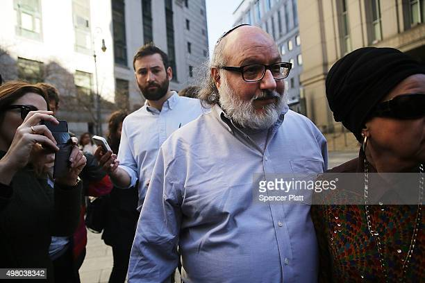 Jonathan Pollard, the American convicted of spying for Israel, leaves a New York court house with an unidentified woman following his release from...