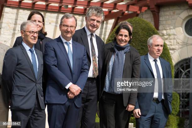 Jonathan Powell former Downing Street Chief of Staff and chief British negotiator on Northern Ireland poses alongside members of the International...