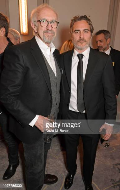 Jonathan Pryce and Joaquin Phoenix attend the 92nd Academy Awards Champagne Tea reception at The Biltmore on January 31, 2020 in London, England.