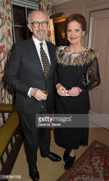 Jonathan Pryce and Kate Fahy attend the Charles Finch CHANEL PreBAFTA Party at 5 Hertford Street on February 1 2020 in London England