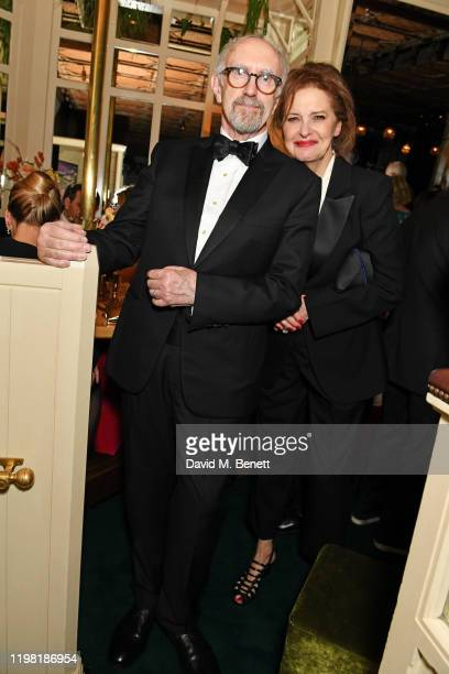 Jonathan Pryce and Kate Fahy pose the Netflix BAFTA after party at Chiltern Firehouse on February 2 2020 in London England