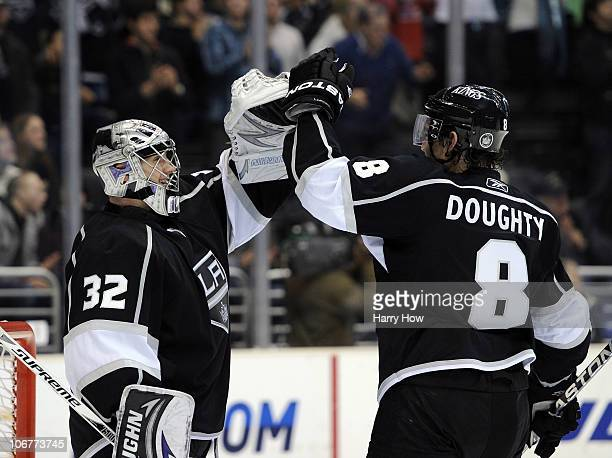 Jonathan Quick and Drew Doughty of the Los Angeles Kings celebrates a 31 win over the Dallas Stars at the Staples Center on November 11 2010 in Los...