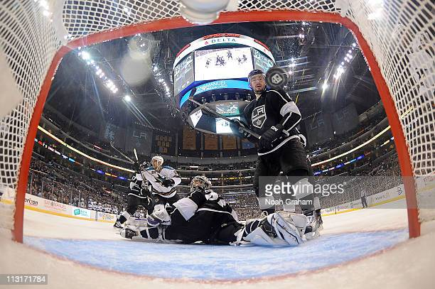 Jonathan Quick and Drew Doughty of the Los Angeles Kings react as the puck goes in the net against the San Jose Sharks in Game Six of the Western...