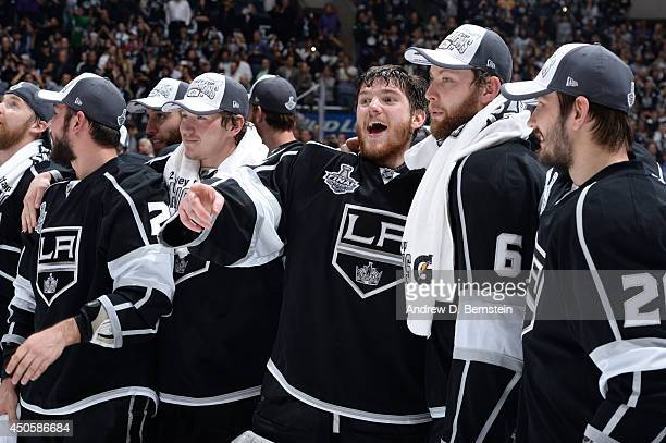 Jonathan Quick and Jake Muzzin of the Los Angeles Kings react after defeating the New York Rangers in the the second overtime period of Game Five of...