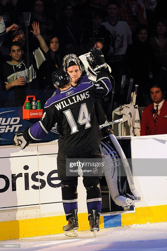 Jonathan Quick #32 and Justin Williams #14 of the Los Angeles Kings high five after defeating the Tampa Bay Lightning at Staples Center on November 4, 2010 in Los Angeles, California.