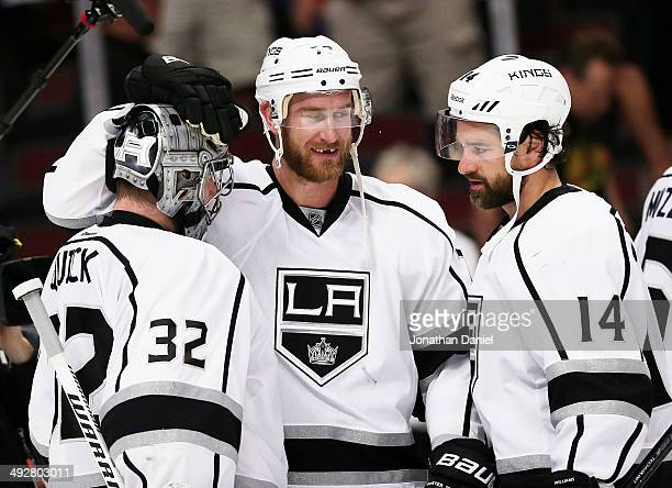 Jonathan Quick Jeff Carter and Justin Williams of the Los Angeles Kings celebrate their 6 to 2 win over the Chicago Blackhawks in Game Two of the...