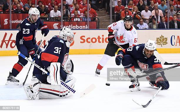 Jonathan Quick makes a save with Dustin Byfuglien of Team USA diving in front during the World Cup of Hockey 2016 at Air Canada Centre on September...