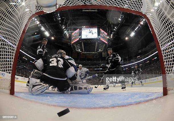 Jonathan Quick Matt Greene and Brad Richardson of the Los Angeles King react to the goal of Christian Ehrhoff of the Vancouver Canucks during the...