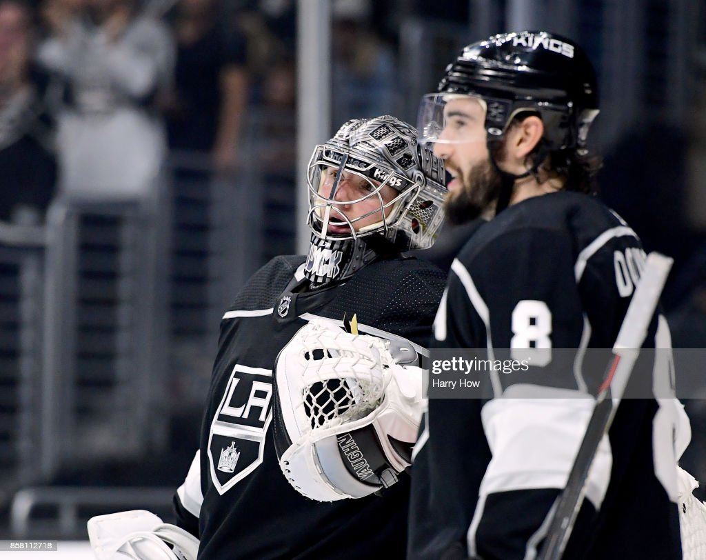 Jonathan Quick #32 of the Los Angeles Kings and Drew Doughty #8 talk after a stop in play during a 2-0 win over the Philadelphia Flyers on opening night of the Los Angeles Kings 2017-2018 season at Staples Center on October 5, 2017 in Los Angeles, California.