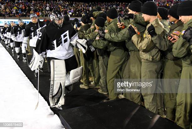 Jonathan Quick of the Los Angeles Kings and his teammates make their way to the ice for the third period of the 2020 NHL Stadium Series game between...