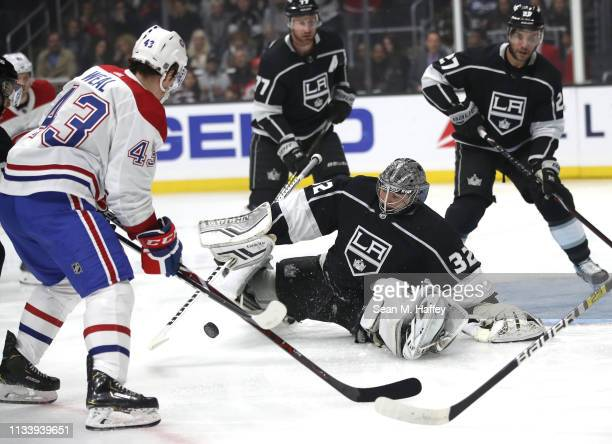 Jonathan Quick of the Los Angeles Kings blocks a shot on goal by Jordan Weal of the Montreal Canadiens during the first period of a game at Staples...