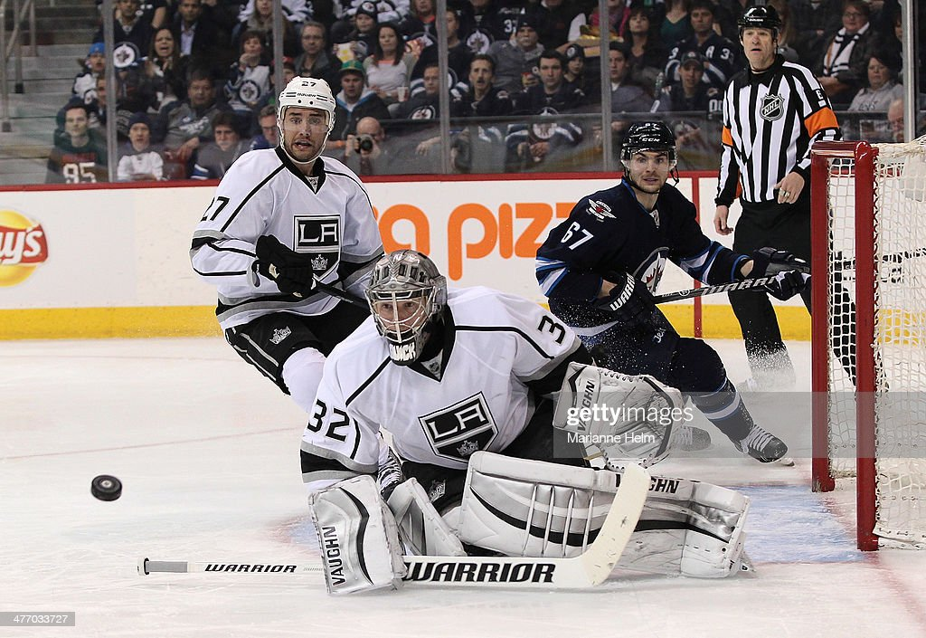 Jonathan Quick #32 of the Los Angeles Kings blocks a shot on goal in second-period action in an NHL game against the Winnipeg Jets at the MTS Centre on March 6, 2014 in Winnipeg, Manitoba, Canada.