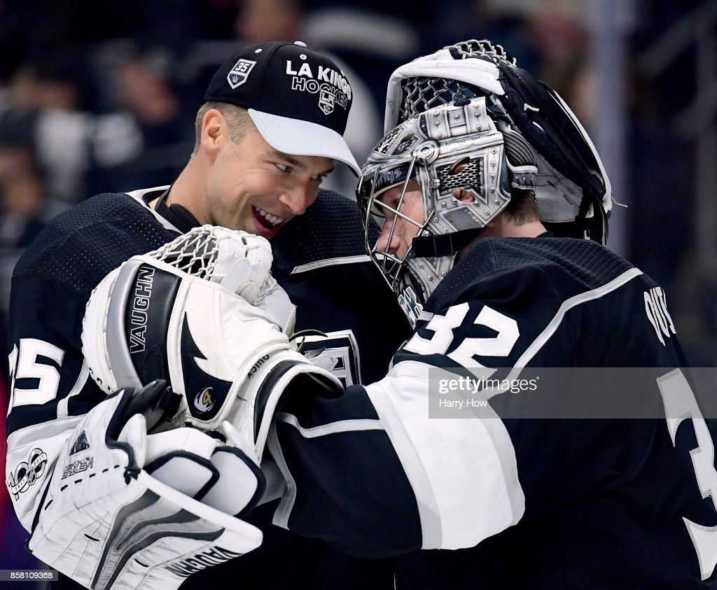 Jonathan Quick #32 of the Los Angeles Kings celebrates a 2-0 win over the Philadelphia Flyers with Darcy Kuemper #35 during opening night of the Los Angeles Kings 2017-2018 season at Staples Center on October 5, 2017 in Los Angeles, California.