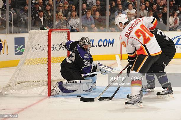 Jonathan Quick of the Los Angeles Kings defends the goal against Curtis Glencross of the Calgary Flames at Staples Center on November 21, 2009 in Los...