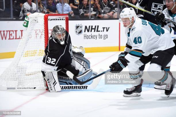 Jonathan Quick of the Los Angeles Kings defends the net against Antti Suomela of the San Jose Sharks at STAPLES Center on October 5 2018 in Los...