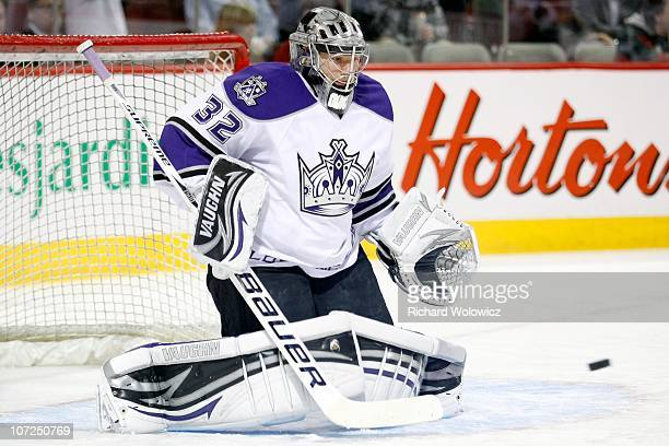 Jonathan Quick of the Los Angeles Kings gets down to stop the puck during the the warm up period prior to facing the Montreal Canadiens in their NHL...