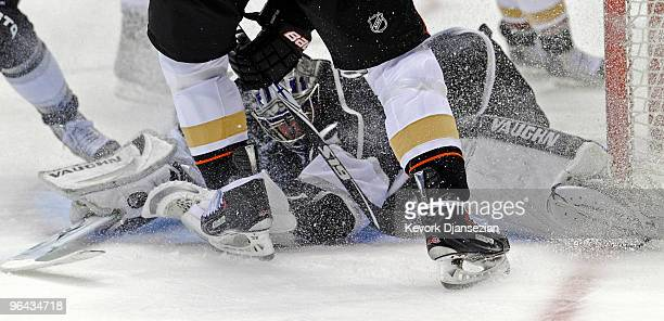 Jonathan Quick of the Los Angeles Kings gets dusted by ice as he makes a save against Teemu Selane of the Anaheim Ducks during the third period of...