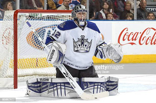 Jonathan Quick of the Los Angeles Kings goes down into the butterfly position against the Edmonton Oilers at Rexall Place on April 7 2009 in Edmonton...