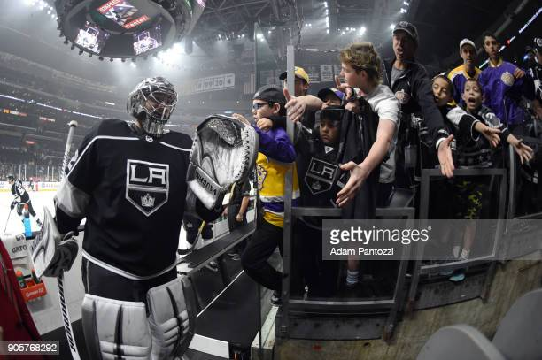 Jonathan Quick of the Los Angeles Kings highfives fans before a game against the San Jose Sharks at STAPLES Center on January 15 2018 in Los Angeles...