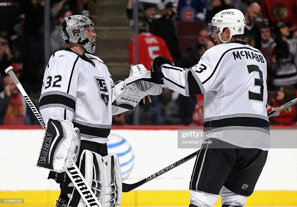 Jonathan Quick #32 of the Los Angeles Kings is congratulated by teammate Brayden McNabb #3 after a shut-out win against the Chicago Blackhawks at the United Center on March 14, 2016 in Chicago, Illinois. The Kings defeated the Blackhawks 5-0.