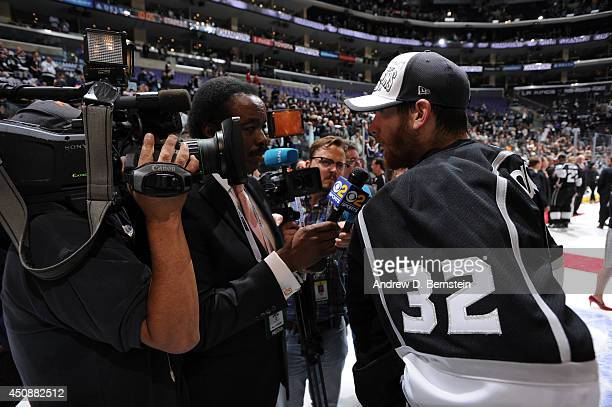 Jonathan Quick of the Los Angeles Kings is interviewed by Jim Hill following Game Five of the 2014 NHL Stanley Cup Final at Staples Center on June 13...