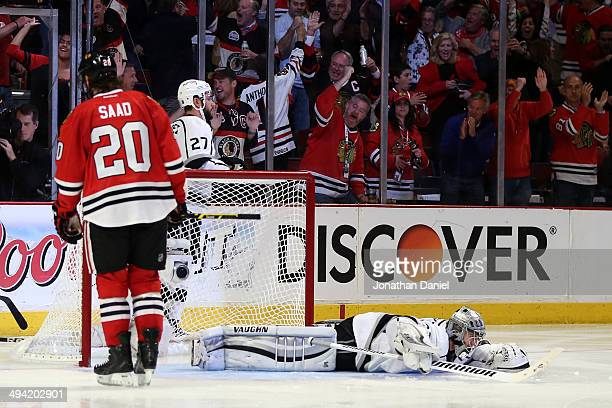 Jonathan Quick of the Los Angeles Kings lays on the ice after giving up a the goal to Ben Smith of the Chicago Blackhawks to tie the game in the...