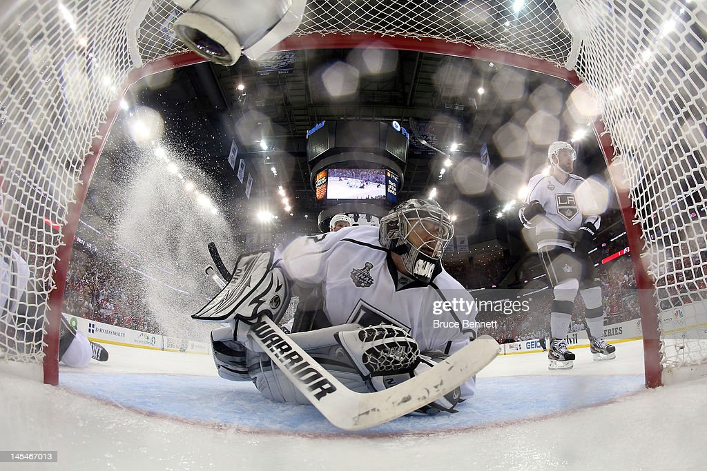 Jonathan Quick #32 of the Los Angeles Kings looks on after a missed shot by Mark Fayne #29 of the New Jersey Devils (not pictured) during Game One of the 2012 NHL Stanley Cup Final at the Prudential Center on May 30, 2012 in Newark, New Jersey.