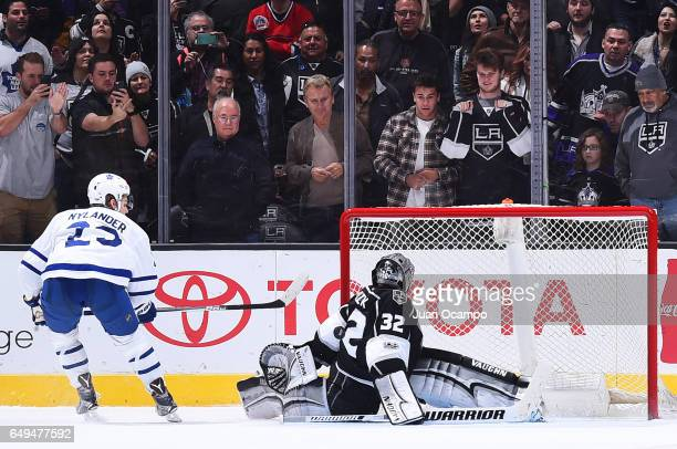 Jonathan Quick of the Los Angeles Kings makes a gamewinning save in a shootout against Nikita Zaitsev of the Toronto Maple Leafs during the game on...