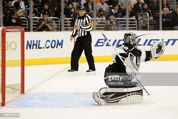 Jonathan Quick of the Los Angeles Kings makes a glove save against the Atlanta Thrashers during their game at Staples Center on October 12 2010 in...