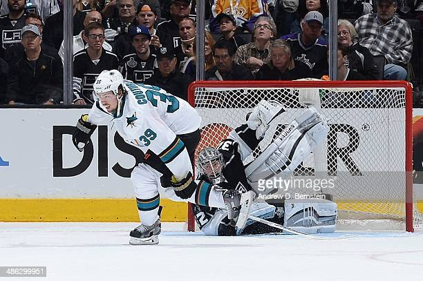 Jonathan Quick of the Los Angeles Kings makes a save against Logan Couture of the San Jose Sharks the San Jose Sharks against the Los Angeles Kings...